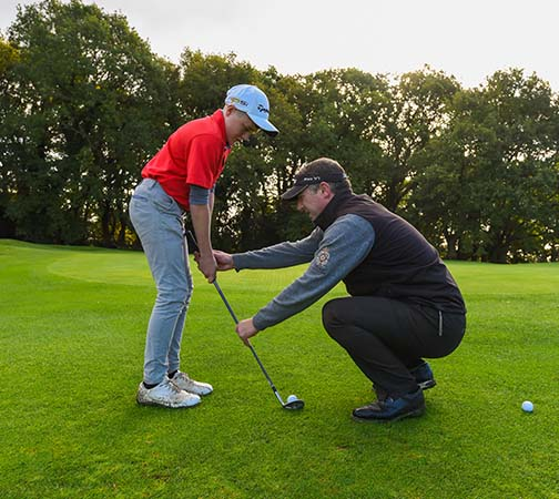 Young golfer and pro at Royal Norwich
