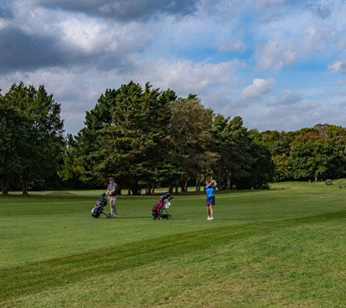 Golfers on fairway at Royal Norwich