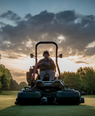 Royal Norwich Greenkeeper cutting grass